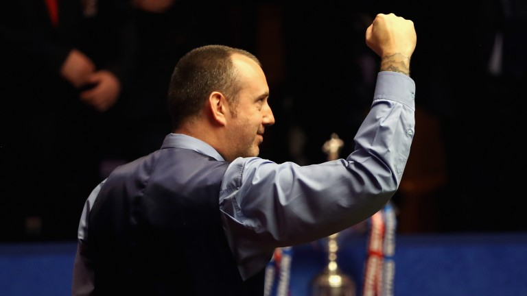 Mark Williams of Wales celebrates when realising he has won the World Championship
