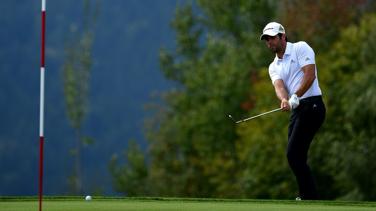 Adrian Otaegui chips onto the green at Crans