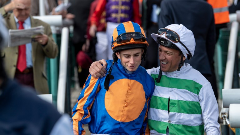 Sharing a moment: Frankie Dettori (right) talks to Ryan Moore on the way to the paddock