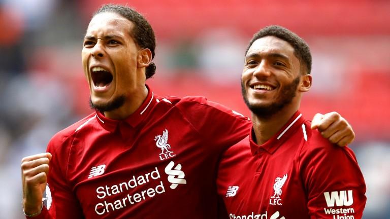 Liverpool's Virgil van Dijk and Joe Gomez celebrate at Wembley