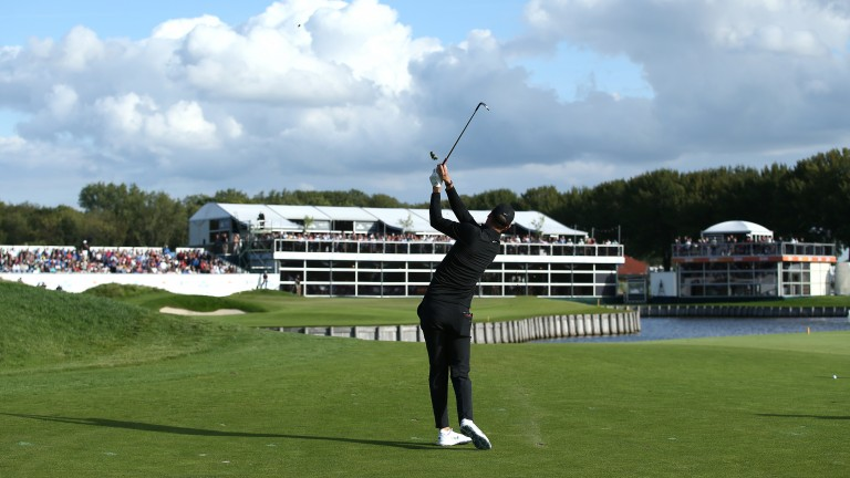 Chris Wood fires at the 18th green during his third round