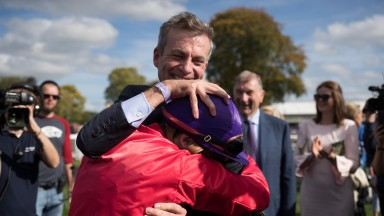 Patrick Prendergast and Ronan Whelan embrace after Skitter Scatter's win in the Moyglare Stud Stakes
