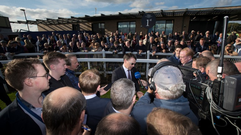 Talking shop: Aidan O'Brien briefs the media after landing his second St Leger in 24 hours