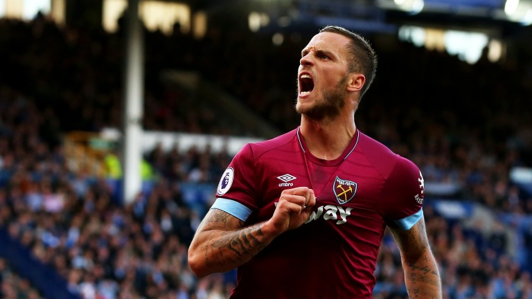 Marko Arnautovic of West Ham celebrates after scoring at Everton