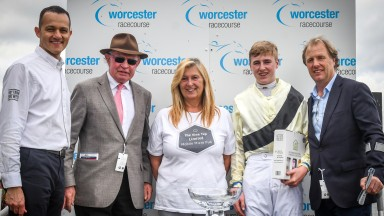 Harry Swan with grandfather Timmy Hyde and father Charlie Swan in the winners enclosure at Worcester after securing his first success in the saddle.