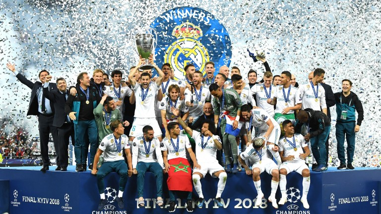 Real Madrid lift the Champions League trophy following victory over Liverpool