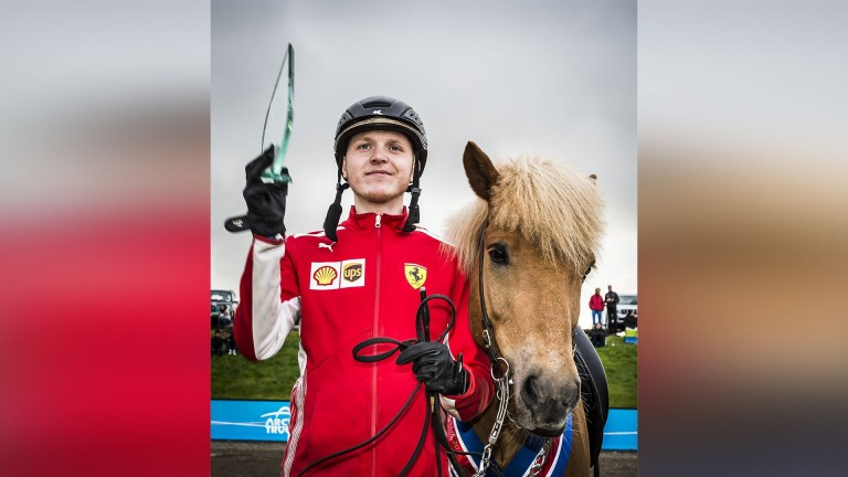 Konrad Valur Sveinsson and Kjarkur fra Arbaejarhjaleigu II winners of the 250m (in world record time) and 100m sprint at Landsmot 2018 receives his trophy for the latter. His winning time for the 100m was 7.51 seconds
