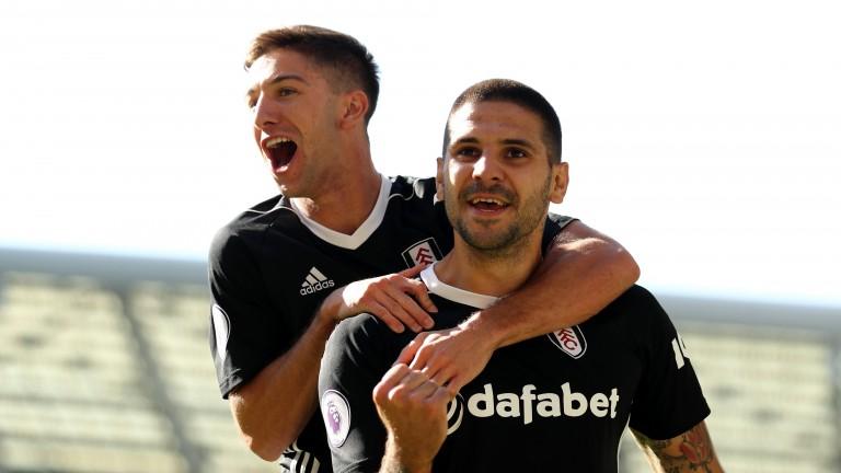 Luciano Vietto jumps on Fulham teammate Aleksandar Mitrovic