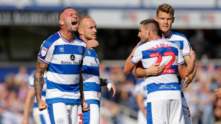 QPR players celebrate a goal against Wigan