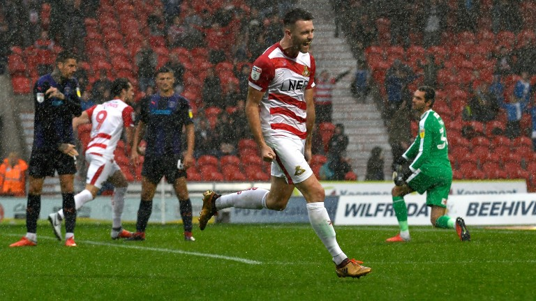 Ben Whiteman clebrates scoring for Doncaster against Luton