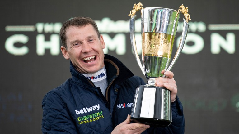 Richard Johnson receives the champion jockey trophy at Sandown