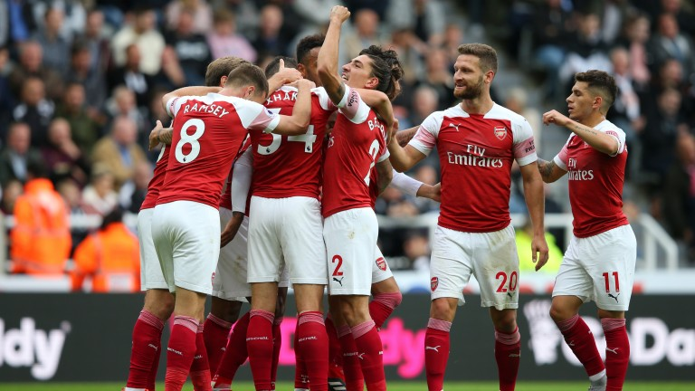 Arsenal celebrate Mesut Ozil's goal against Newcastle