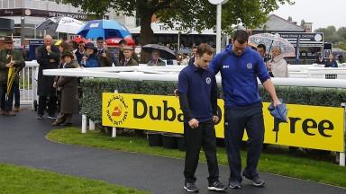 Making progress: paralysed jockey Ed Barrett walks around the Newbury parade ring