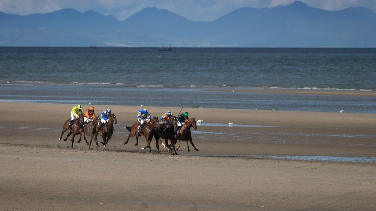 Waqaas (Lisa O'Neill, orange colours) holds off all-comers to win on the beach at Laytown