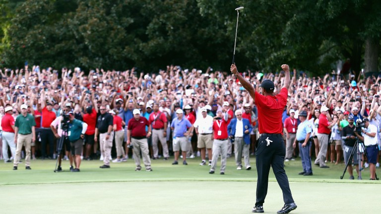 Tiger Woods celebrates sinking his par putt to win last year's Tour Championship