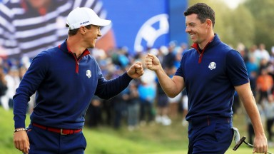 Rory McIlroy shares a smile with Thorbjorn Olesen on the the first morning