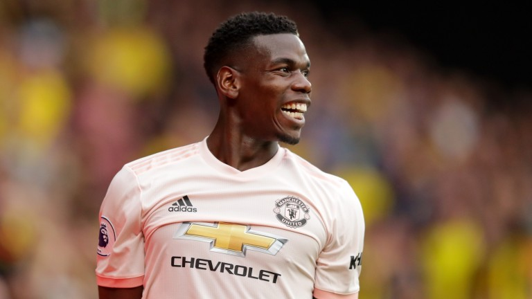 Paul Pogba looks happy in pink