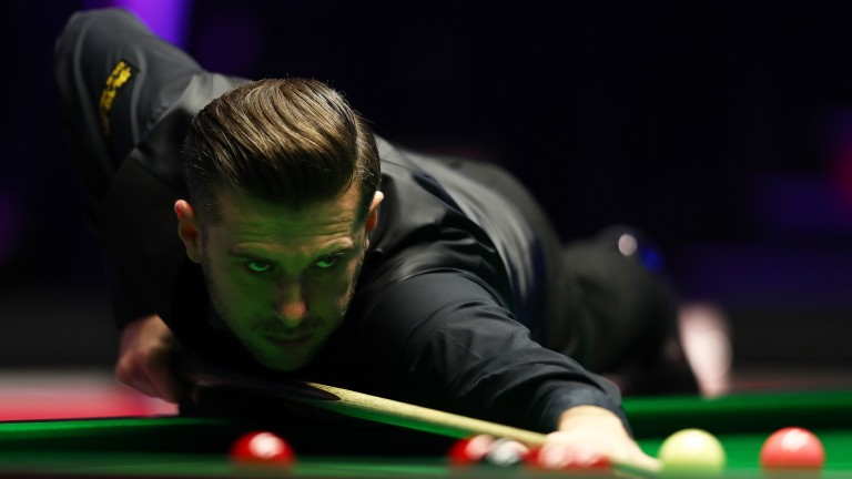 Mark Selby is in action on Monday