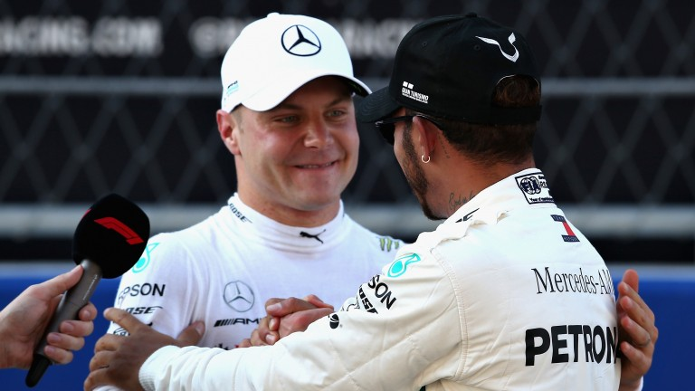 Valtteri Bottas is congratulated by his Mercedes teammate Lewis Hamilton
