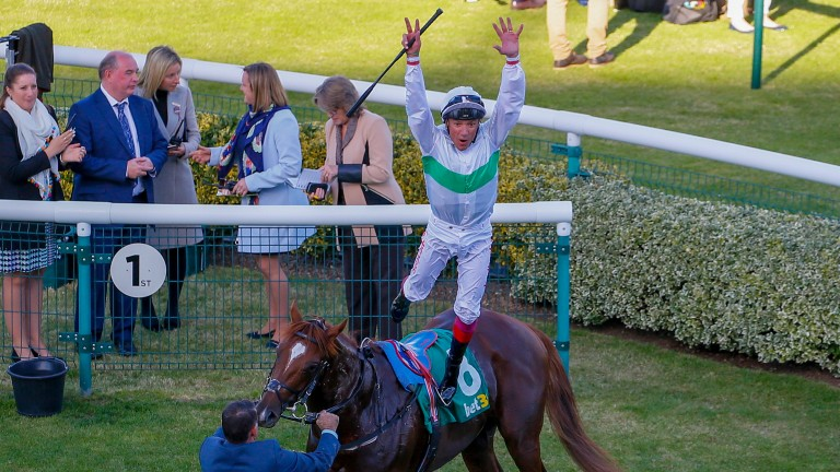 Frankie Dettori celebrates Cambridgeshire victory with a flying dismount from Wissahickon
