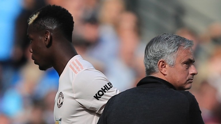 Paul Pogba walks past Jose Mourinho after being substituted
