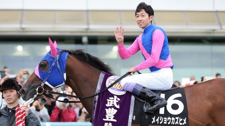 Yutaka Take celebrates reaching 4,000 winners on Saturday at Hanshin