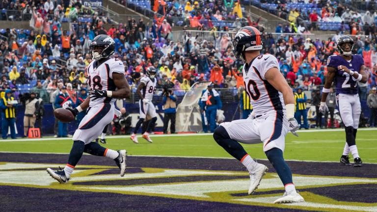 Royce Freeman of the Denver Broncos scores a touchdown