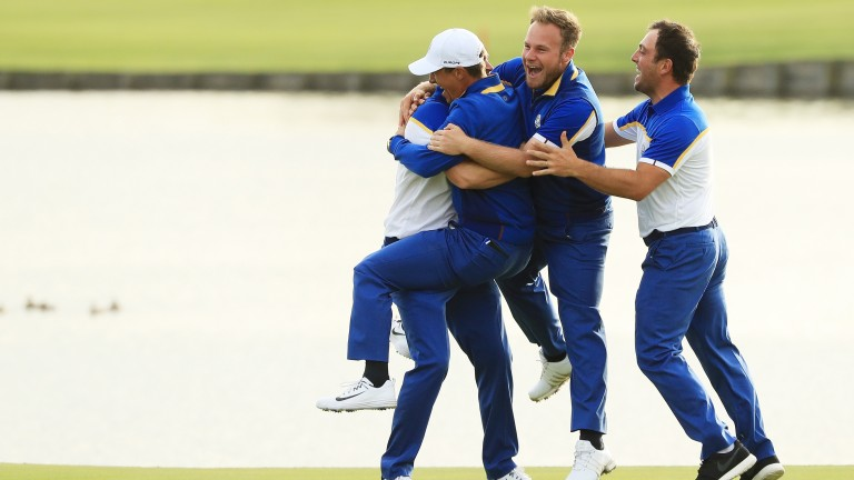 Alex Noren of Europe celebrates with team mates, Thorbjorn Olesen, Tyrrell Hatton and Francesco Molinari
