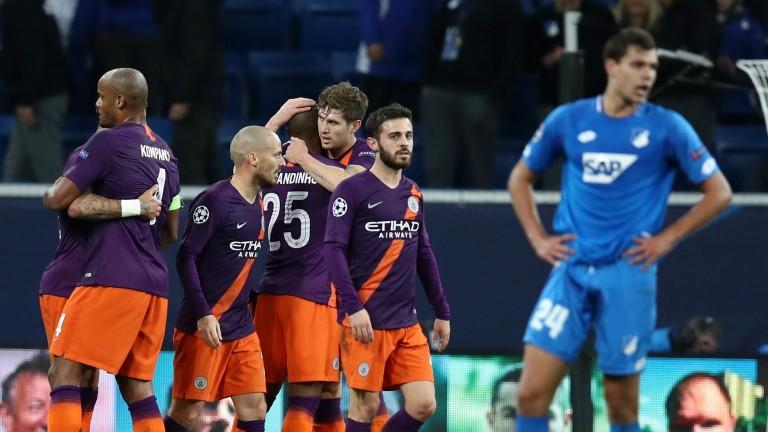 Man City celebrate their late winner against Hoffenheim