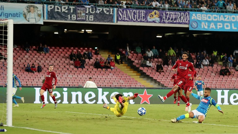 Napoli's Lorenzo Insigne scores against Liverpool at Stadio San Paolo