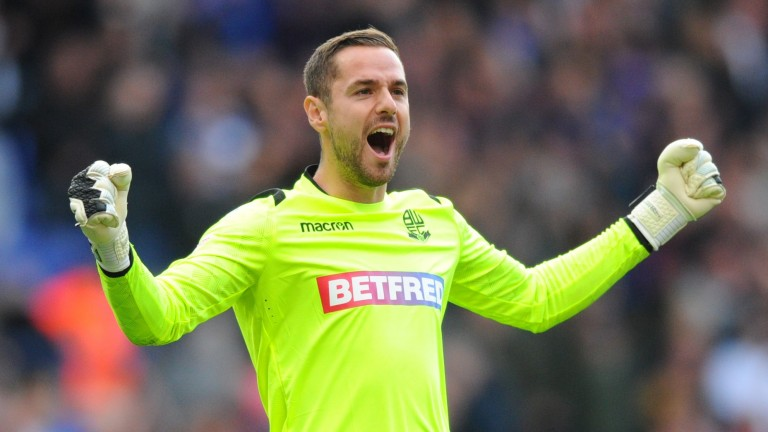 Bolton goalkeeper Remi Matthews celebrates the 1-0 win over Derby