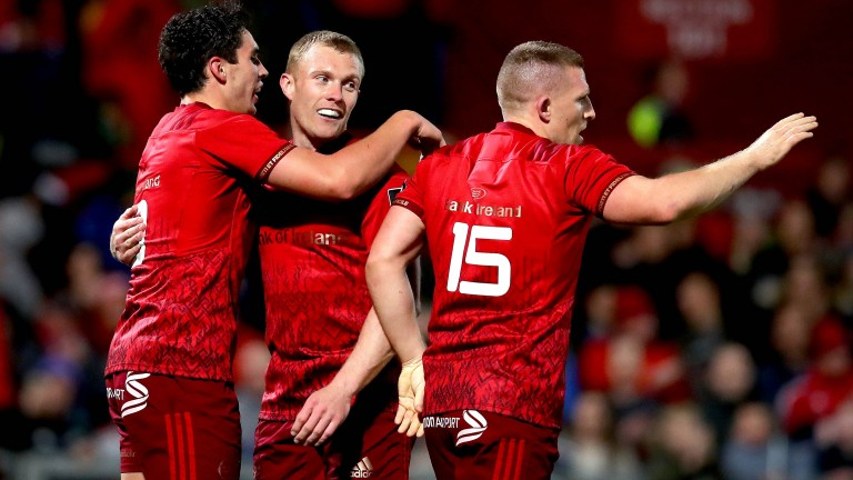 Joey Carbery, Andrew Conway and Keith Earls celebrate a Munster try against Ulster