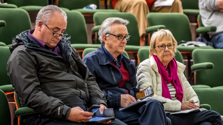 Jim Bolger (centre), wife Jackie and nephew Ken Bolger keep an eye on the action in the ring