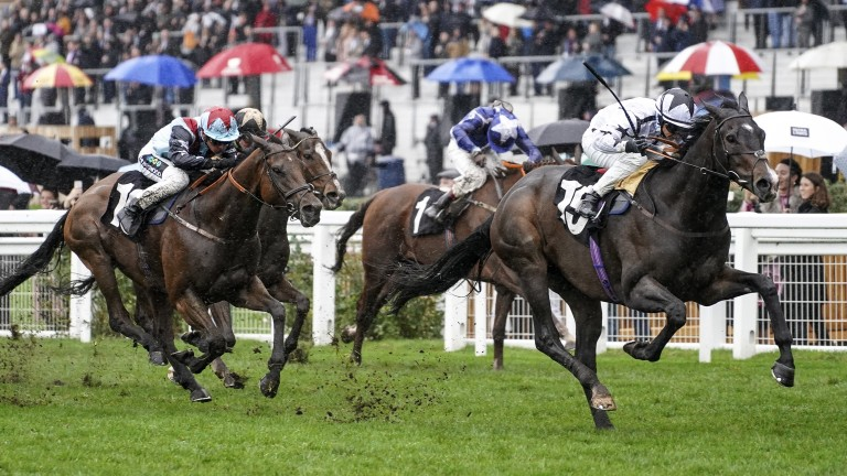 Powering clear: Raising Sand hits the front to win the Ascot Challenge Cup