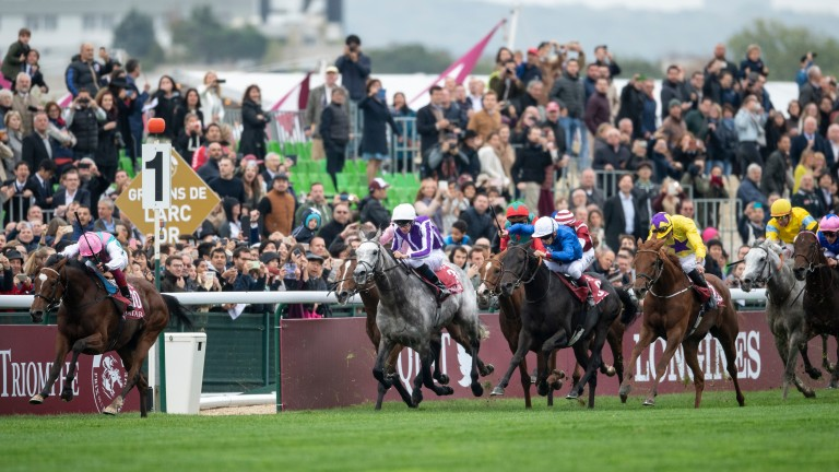 James Doyle (yellow and purple cap) tries to reel in Enable on Sea Of Class