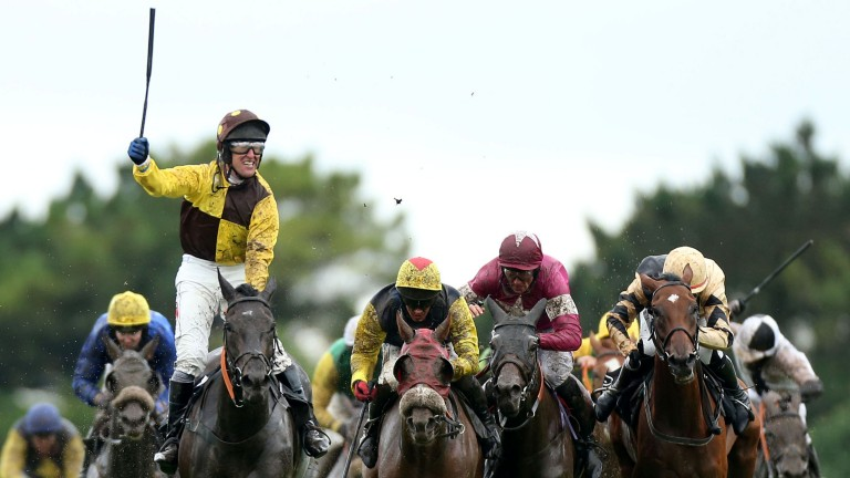 Robbie Power salutes the crowd after winning the 2013 Galway Hurdle on Missunited
