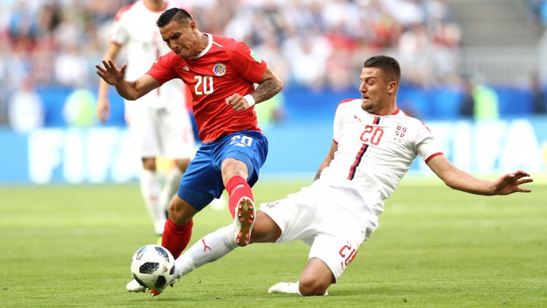 Serbia's Sergej Milinkovic-Savic (right) could be frustrated in Montenegro