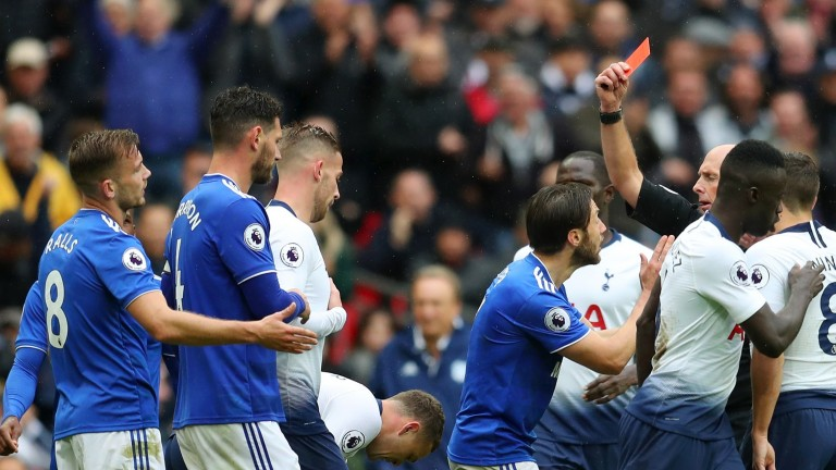 Joe Ralls (far left) is shown the red card for his cynical foul on Lucas Moura
