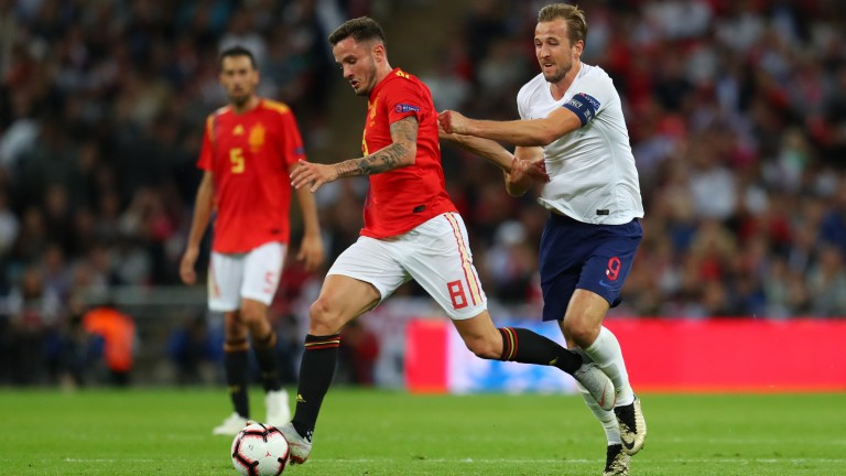 Spain's midfield maestro Saul Niguez shrugs off a Harry Kane challenge