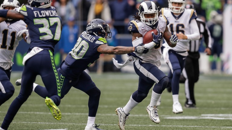 Ace LA Rams running back Todd Gurley stretches the Seattle defence