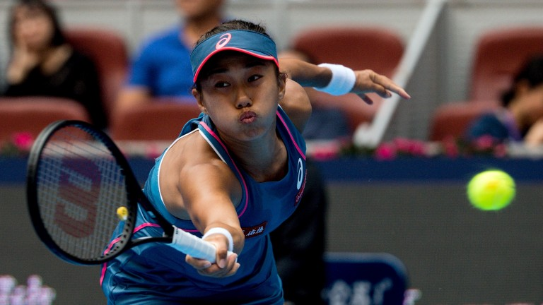 Shuai Zhang reaches wide against Naomi Osaka in Beijing last week