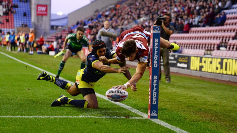Wigan's Oliver Gildart scores a spectacular try against Wakefield