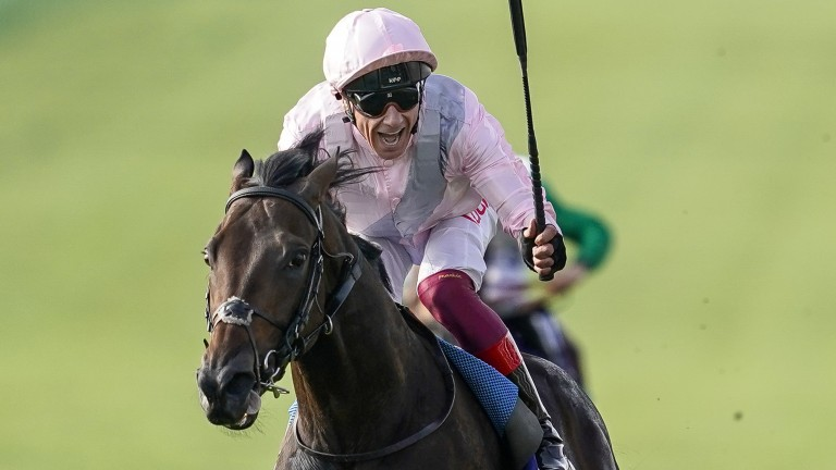 NEWMARKET, ENGLAND - OCTOBER 13:  Frankie Dettori riding Too Darn Hot celebrates early as they win The Darley Dewhurst Stakes at Newmarket Racecourse on October 13, 2018 in Newmarket, United Kingdom. (Photo by Alan Crowhurst/Getty Images)