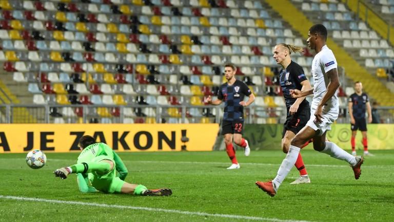 Marcus Rashford's shot is saved in England's 0-0 draw with Croatia