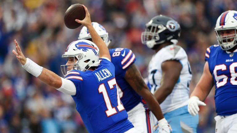 Buffalo Bills QB Josh Allen celebrates a TD against Tennessee