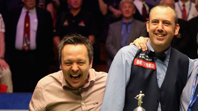 Lee Walker (left) helps good friend Mark Williams celebrate his world title triumph in May