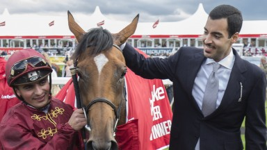 DONCASTER, ENGLAND - SEPTEMBER 12:  Simple Verse ridden with jockey Andrea Atzeni and owner Sheikh Fahad Al Thani after a controversial runing of The Ladbrokes St Leger Stakes Race run at Doncaster Racecourse on September 12, 2015 in Doncaster, England. (