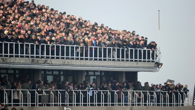 CHELTENHAM, ENGLAND - MARCH 13:  Crowds pack the grandstands on St Patrick's Thursday at Cheltenham Racecourse on March 13, 2014 in Cheltenham, England.  (Photo by Mike Hewitt/Getty Images)