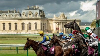 October: History and histrionics ? the grey filly Minamya rears leaving the stalls for the Prix Chaudenay at Chantilly. In the background are Les Grandes Ecuries ? the stables built because the Prince de Conde thought he would be reincarnated as a horse