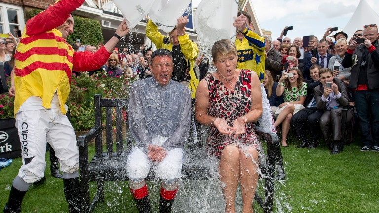 August: Wash down for New Approach - stallion men Ken Crozier (left) and Darren Palmer get doused as stallion New Approach shakes himself at Dalham Hall. New Approach won the 2008 Derby and ten years later his son Masar was to do the same